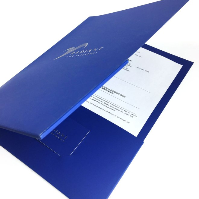 Radiant Life Insurance folder with business card holder.